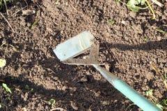 Hoeing the garden. Royalty Free Stock Photos