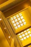 Hoekige mening van dakraamvensters met gele muren, moderne binnenlandse architectuur royalty-vrije stock afbeeldingen