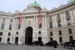 Hofburg. Traditional Fiaker on Michaelerplatz in front of Hofburg z in Vienna royalty free stock photos