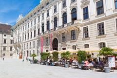 Hofburg court with cafe and Sisi museum, Vienna, Austria. Inner castle court with people on outdoor terrace of cafe and Sisi museum, Hofburg Palace, Vienna royalty free stock images
