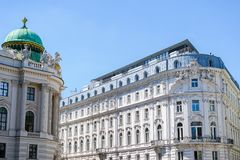 Hofburg imperial palace of Habsburg dynasty near building in Vienna, Austria. Hofburg imperial palace of Habsburg dynasty near building in Wien, Austria royalty free stock image