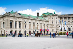 Hofburg palace, square view and fiacre or fiaker in Vienna Stock Image