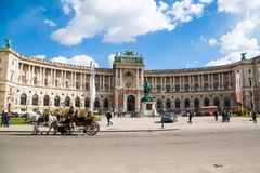 Hofburg palace, square view and fiacre or fiaker in Vienna Royalty Free Stock Images
