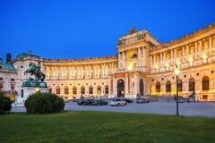 Hofburg Palace in Vienna, Austria. Statue of Emperor Joseph II Evening view with illuminated building. VIENNA, AUSTRIA - AUGUST 30, 2013; Hofburg Palace. Was Royalty Free Stock Photos