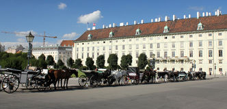 Hofburg Palace, Wien, Austria. Carriages waiting for the tourists in the court of the Hofburg Palace, Wien, Austria royalty free stock photo