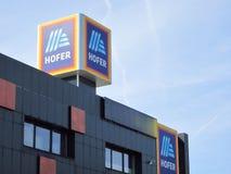 Hofer sign against blue sky. Aldi parent comapny stock images