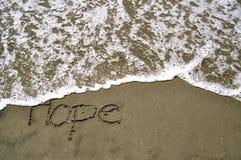 Hoffnung im Sand Stockbild
