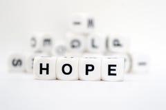 Hoffnung, Würfelbuchstaben Stockbild