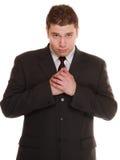 Hoffnungsloser Mann, der Verzeihen um suppliant Hilfe bittet Lizenzfreies Stockfoto