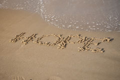 Hoffnungsmitteilung auf dem Strandsand Lizenzfreie Stockfotografie