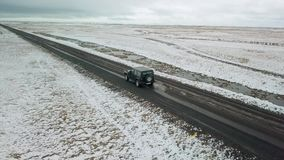 Driving in Icelandic countryside. Hofn, Iceland - May 04, 2018. Jeep Wrangler Unlimited driving in Icelandic countryside, aerial drone footage. Gravel roads ar stock footage
