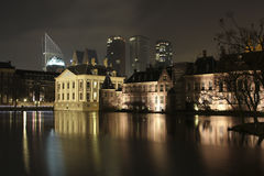 Hofvijver. Binnenhof with mauritshuis from the hofvijver with the skyline of the Hague at the background royalty free stock photos