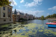 The Hofvijver court pond in front of the buildings of the Dutch parliament, The Hague, Netherlands. A view on the Hofvijver court pond and the Dutch parliament stock photography