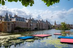 The Hofvijver court pond in front of the buildings of the Dutch parliament, The Hague, Netherlands. A view on the Hofvijver court pond and the Dutch parliament stock photo