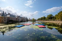 The Hofvijver court pond in front of the buildings of the Dutch parliament, The Hague, Netherlands. A view on the Hofvijver court pond and the Dutch parliament stock images