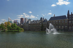Hofvijver fountain and a small island overgrown with plants. Stock Photo