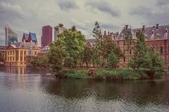 Hofvijver lake with the Binnenhof Gothic government buildings and skyscrapers in The Hague. royalty free stock photos