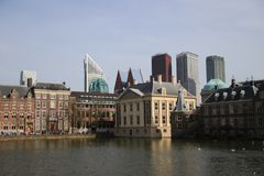Hofvijver pool along Mauritshuis and Binnenhof with the skyscraper skyline of The Hague the Netherlands. Hofvijver pool along Mauritshuis and Binnenhof with the royalty free stock photos
