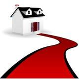 Hogar con la calzada de la alfombra roja a la casa