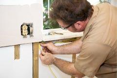 Hogar del cableado del electricista Fotografía de archivo libre de regalías