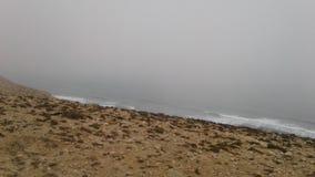 Hogar en la cueva Marruecos de la playa de la roca Foto de archivo libre de regalías