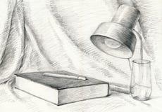 Hogar, libro, lámpara, pañería Fotografía de archivo