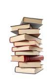 Hoge stapel boeken stock foto's