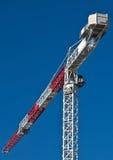Hoge stijgingskranen op bouwwerf Stock Foto