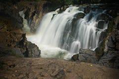 Hogenakkal Waterfalls. Waterfalls at Hogenakkal in India. Water flows smoothly over rocks Royalty Free Stock Image