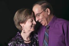 Hoger die Paar op een zwarte Achtergrond wordt geïsoleerd stock foto