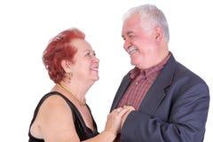 Hoger Paar dat elkaar gelukkig bekijkt trots en stock foto