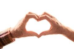 Hoger paar dat hart met handen vormt Stock Fotografie