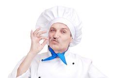 Hogere chef-kok die gastronomisch gebaar maakt Royalty-vrije Stock Afbeelding