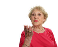 Hogere Dame Blows een Kus royalty-vrije stock fotografie