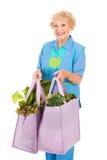 Hogere Dame Shops Green Royalty-vrije Stock Afbeeldingen