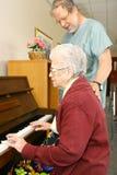 Hogere het spelen piano royalty-vrije stock afbeeldingen