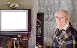 Hogere mens het letten op televisie royalty-vrije stock afbeelding