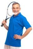 Hogere mens met een tennisracket Stock Foto