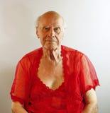Hogere mens in rode lingerie. Stock Afbeelding