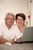 Hogere mensen en technologie Royalty-vrije Stock Foto's