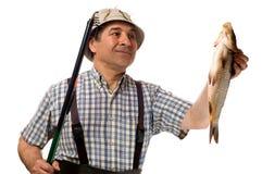 Hogere visser met hengel en zijn vangst stock afbeelding