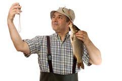 Hogere visser met zijn vangst royalty-vrije stock fotografie