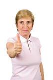 Hogere vrouw die duim-omhoog geeft Stock Afbeeldingen