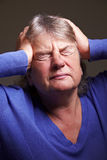 Hogere vrouw met migraine Stock Afbeelding