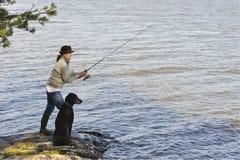 Hogere vrouw visserij royalty-vrije stock foto's