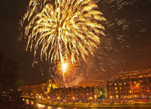 Hogmonay at Inverness. Fireworks at midnight on 1st January 2015  over Inverness Cathedral beside River Ness Stock Photo