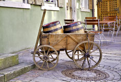 Hogshead in a wooden vehicular. In a wooden vehicular laying two wine barrel for decoration Royalty Free Stock Image