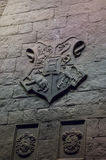 The Hogwarts crest. Above the fireplace in the great hall Stock Photos