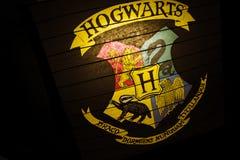 Hogwarts magic school logo on black background