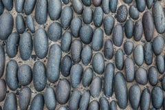 In hohem Grade ausführliches Bild der Kopfsteinpflasterung Stockfotos